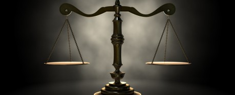 http://www.dreamstime.com/royalty-free-stock-image-scales-justice-gold-scale-backlight-eerie-dark-background-image37740506